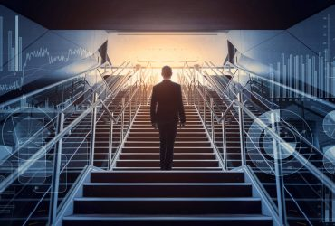 cso_nw_leadership_sucess_businessman_ascending_staircase_surrounded_by_symbols_of_business_acumen_by_metamorworks_gettyimages-957655008-100801476-large